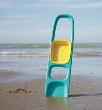 Лопатка scoppi на фоне пляжа